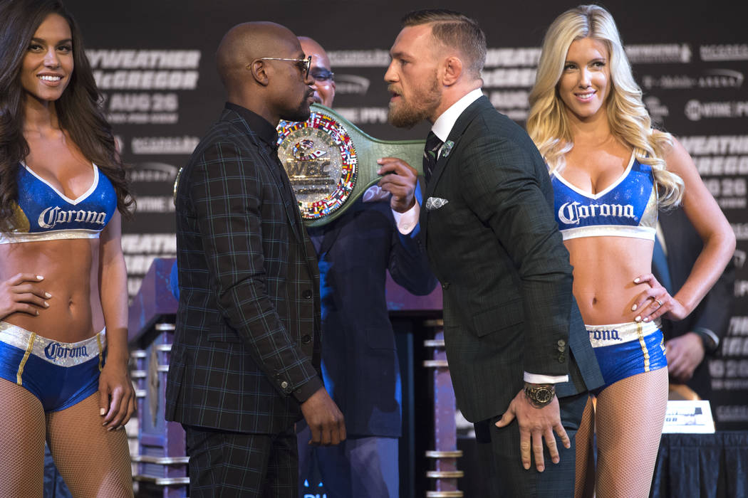 Floyd Mayweather, left, and Conor McGregor face off during the final news conference Wednesday, Aug. 23, 2017, at the MGM Grand before their scheduled Aug. 26 fight. Sam Morris/Las Vegas News Bureau