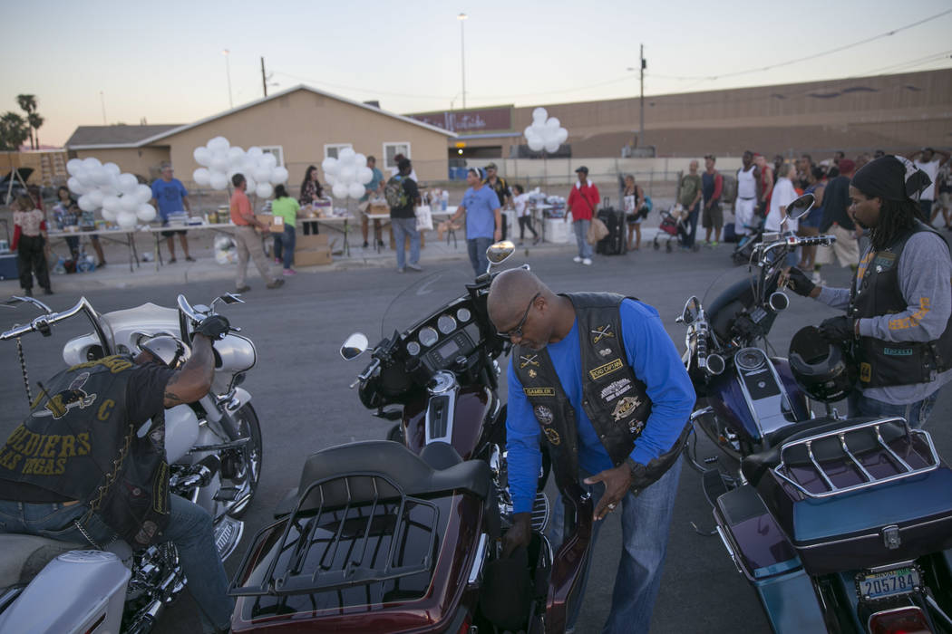 """Rodney """"Gambler"""" Anderson, center, and Scott """"Tux"""" Simmons, right, of the Buffalo Soldier Motorcycle Club of Las Vegas arrive at the Homeless Lives Matter free dinner in slain homeless man Daniel  ..."""