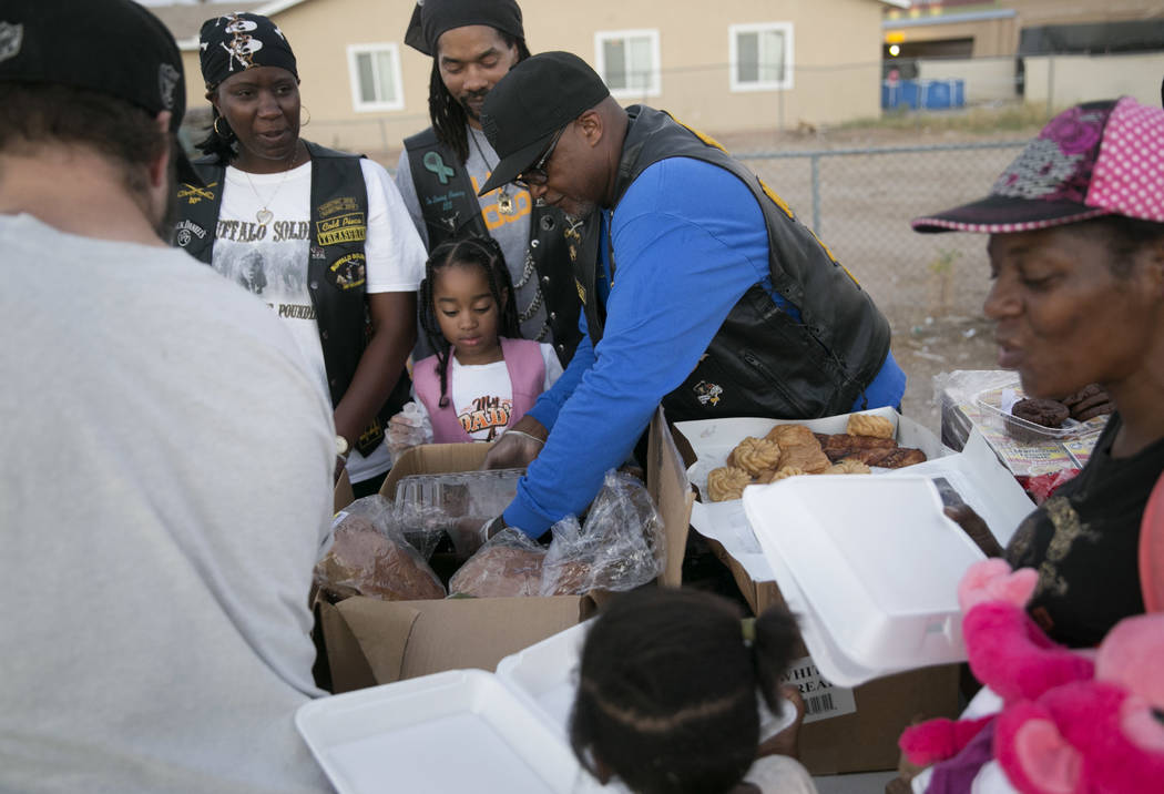 """Melissa """"Cold Piece"""" Wesley, from left,  Caedence """"Sweet Pea"""" Simmons, her father Scott """"Tux"""" Simmons and Rodney """"Gambler"""" Anderson pass out food during the Homeless Lives Matter free dinner in sl ..."""