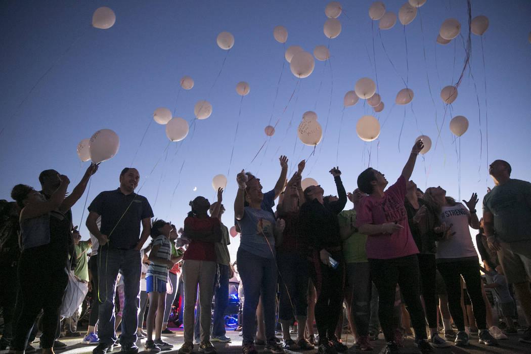 Event volunteers and family of slain homeless man Daniel Aldape release balloons during the Homeless Lives Matter free dinner in Aldape's memory, Thursday, Aug. 24,  2017, in Las Vegas.  Gabriella ...