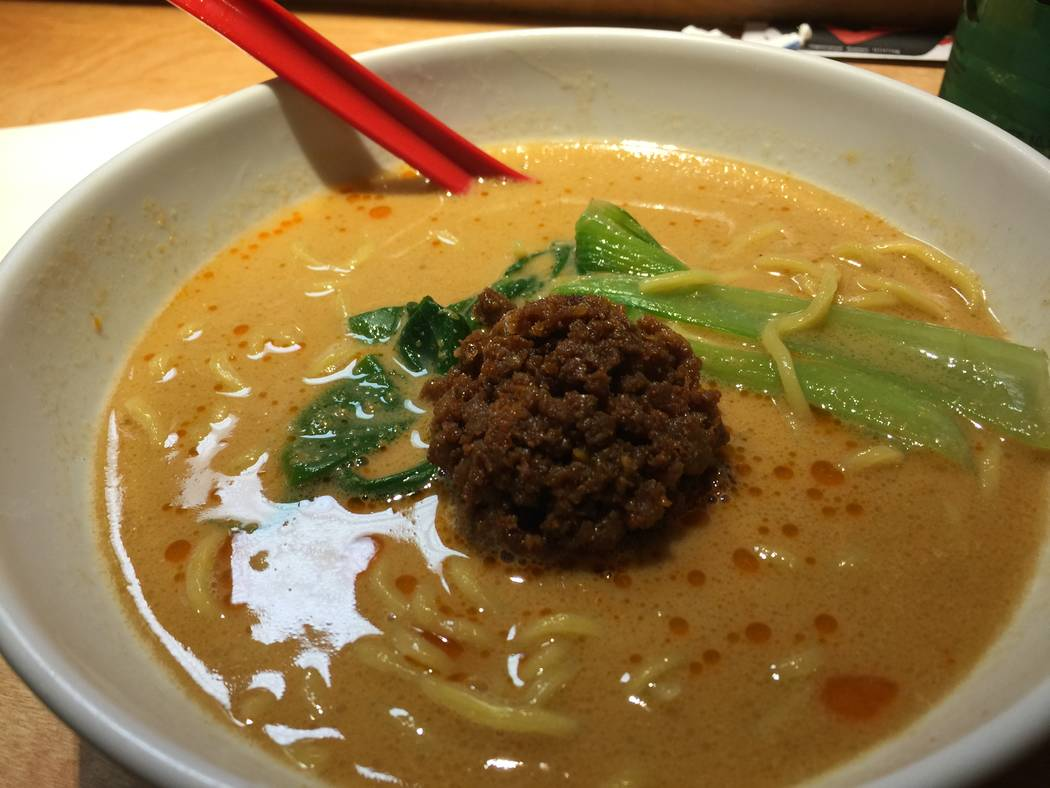 The Tantan Men at Fukumimi Ramen. The dish includes spicy ramen with sesame sauce and red chili oil, topped with seasoned ground pork and bok choy. (Briana Erickson/Las Vegas Review-Journal) @bria ...