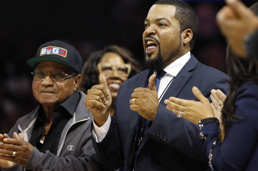 """BIG3 Basketball League founder Ice Cube, right, mouths out """"Thank You"""" to the crowd who applauds him as he is announced during a timeout in the the first half of Game 3 of the le ..."""