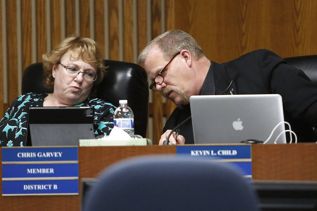 Clark County School Board Trustee Kevin L. Child, right, speaks to Chris Garvey during a board meeting at the Edward A. Greer Center on Thursday, Feb. 23, 2017, in Las Vegas. (Christian K. Lee/Las ...