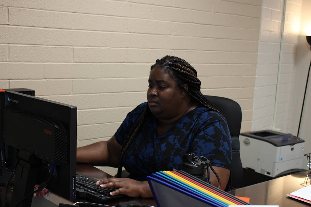 Lakeisha Young, principal at C.W. Woodbury Middle School, works at her desk on Aug. 22.
