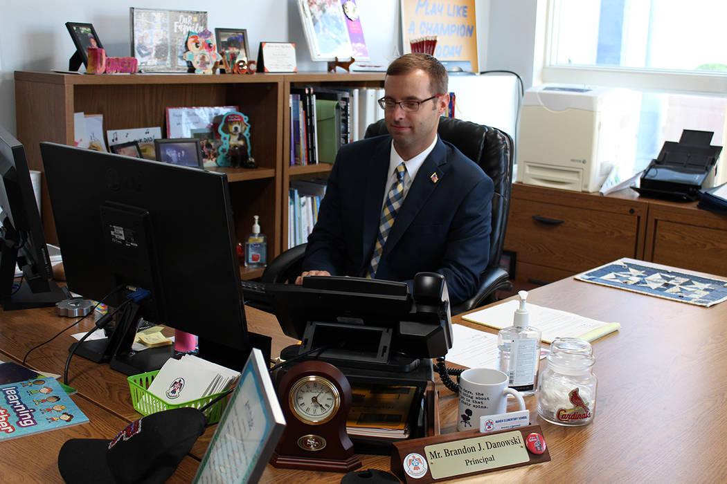Brandon Danowski, principal at Jacob E. Manch Elementary, works at his desk on Aug. 24.