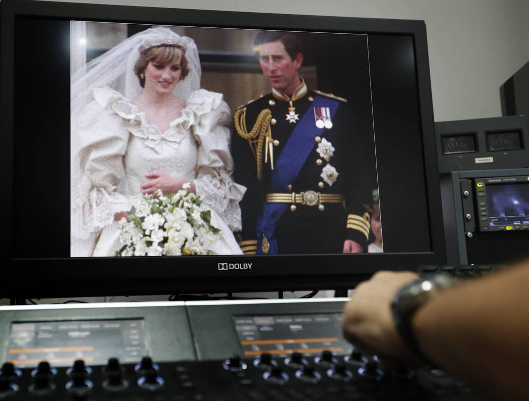 A 35mm film of the wedding of Britain's Prince Charles and Lady Diana Spencer is colour graded by Gerry Gedge after it has been digitised, at R3store lab in London, Friday, Aug. 18, 2017. Thirty-s ...