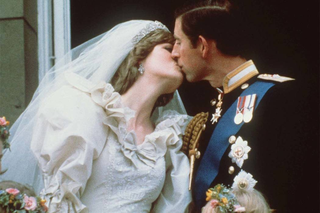 In this July 29, 1981 file photo, Britain's Prince Charles kisses his bride, the former Diana Spencer, on the balcony of Buckingham Palace in London after their wedding. Thirty-six years after Lad ...