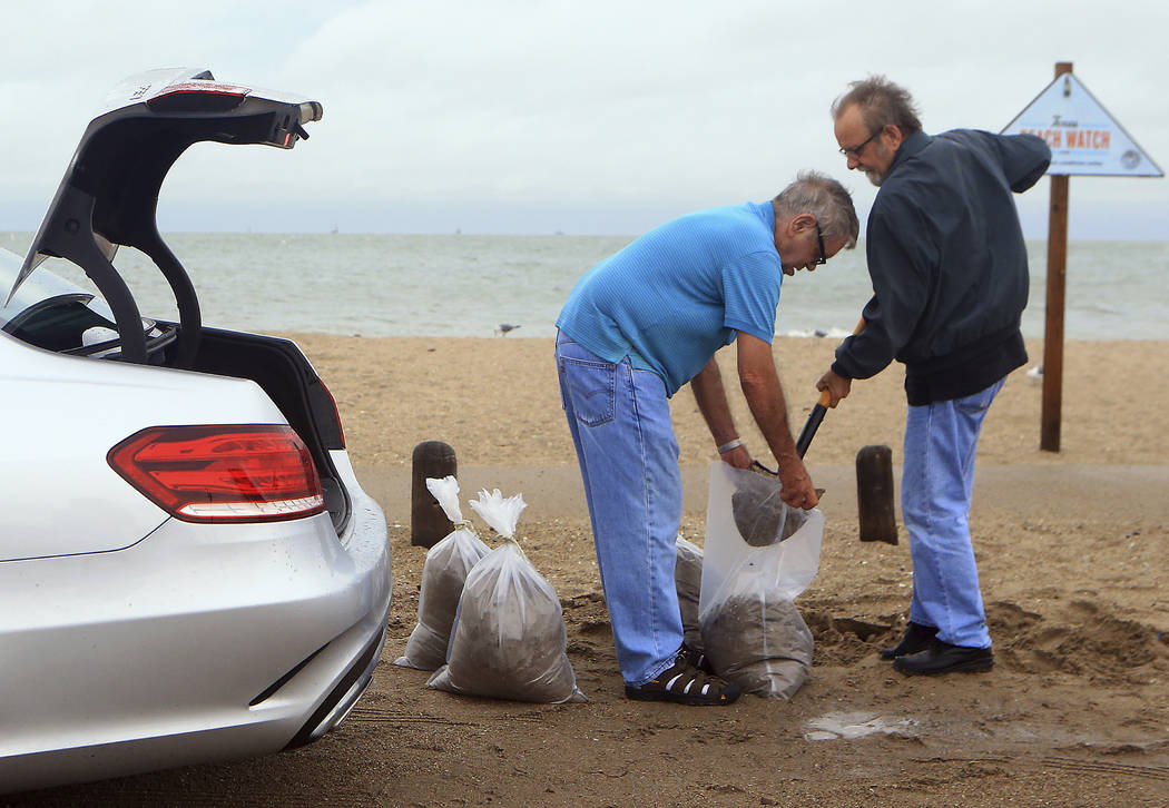Tom Corbin, right, and Terry Corbin prepare sandbags as Hurricane Harvey approaches the Coastal Bend area on Friday, Aug. 25, 2017, in Corpus Christi, Texas. (Gabe Hernandez/Corpus Christi Caller- ...