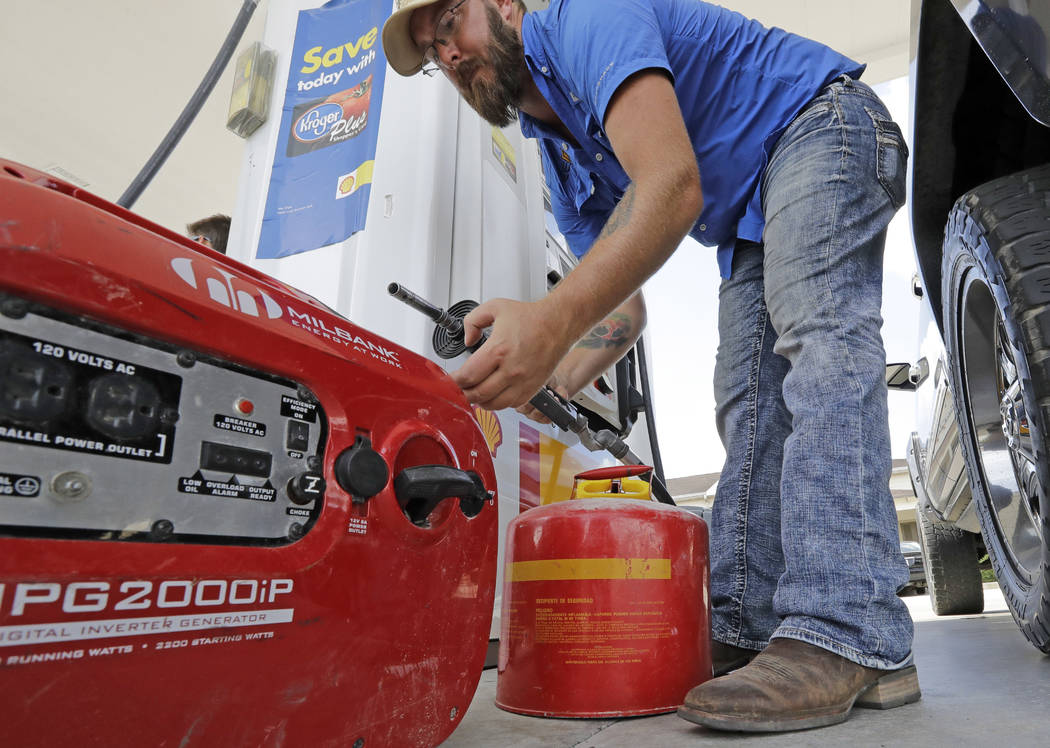 Aaron Berg fills up a gas can and his portable generator Thursday, Aug. 24, 2017, in Houston as Hurricane Harvey intensifies in the Gulf of Mexico. Harvey is forecast to be a major hurricane when  ...