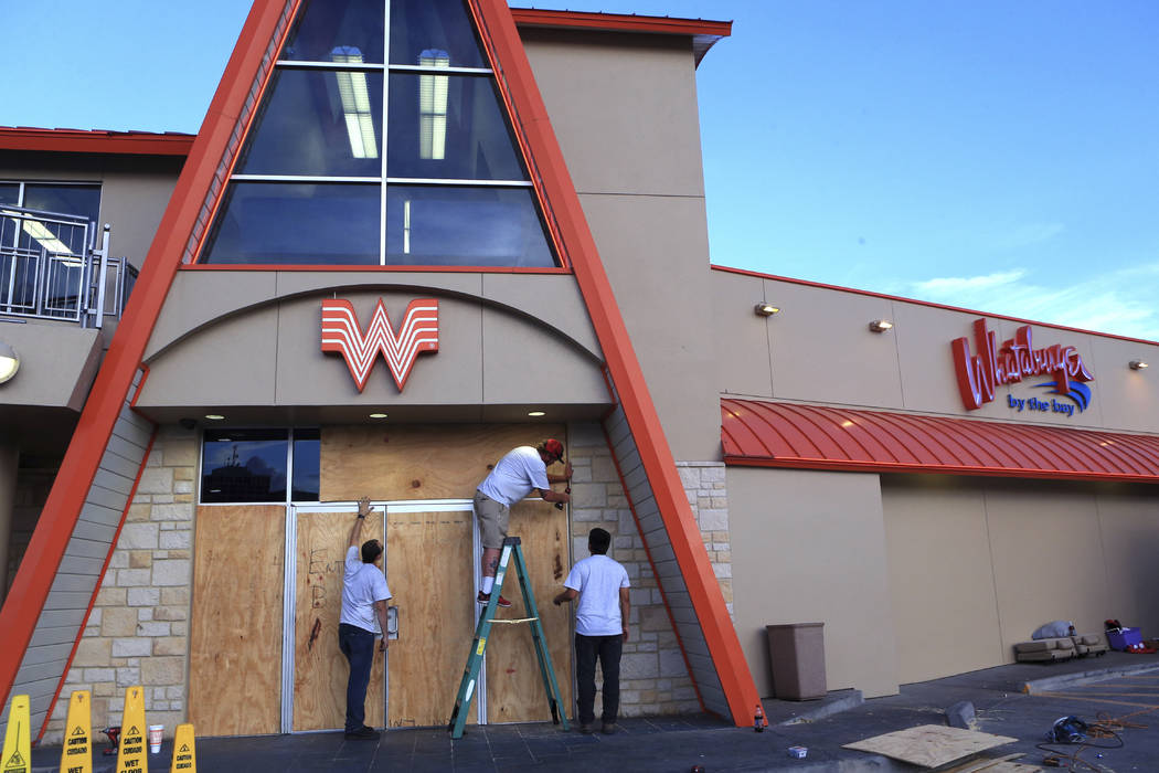 Whataburger by the Bay in Corpus Christi, Texas, is boarded up on Thursday, Aug. 24, 2017, in preparation for Hurricane Harvey.  (Rachel Denny Clow/Corpus Christi Caller-Times via AP)