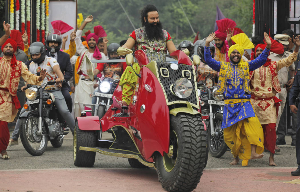 In this Wednesday, Oct. 5, file 2016 photo, Indian spiritual guru, who calls himself Saint Dr. Gurmeet Ram Rahim Singh Ji Insan, arrives for a press conference ahead of the release of his new film ...
