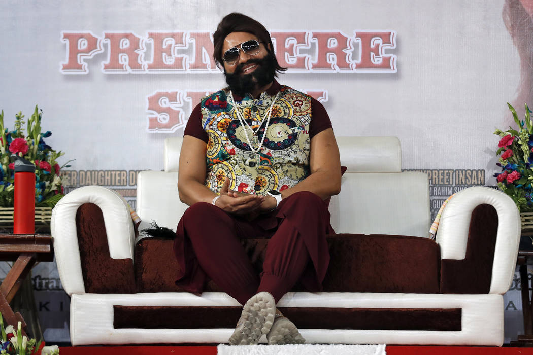 In this May 17, 2017 file photo, an Indian spiritual guru, who calls himself Saint Dr. Gurmeet Ram Rahim Singh Ji Insan, attends the premiere of the movie 'Jattu Engineer' in New Delhi, India. A n ...