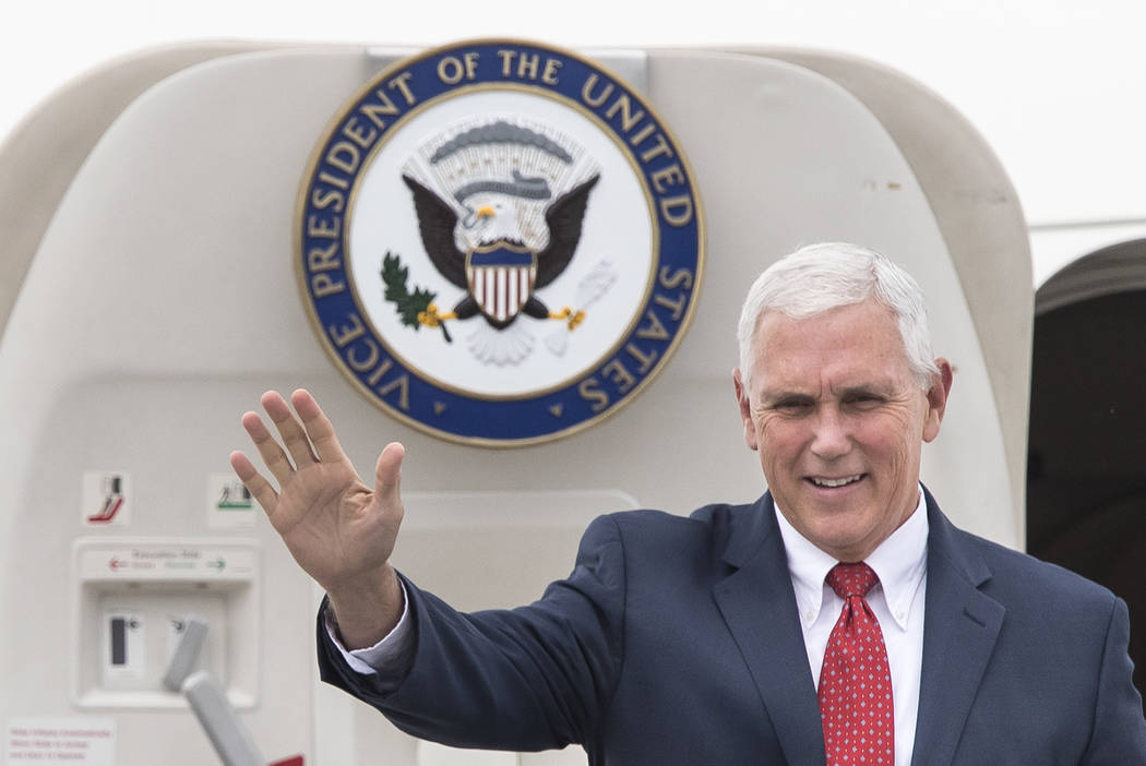 U.S. Vice President Mike Pence waves as he arrives at the airport in Tallinn, Estonia, Sunday, July 30, 2017. (AP Photo/ Mindaugas Kulbis)