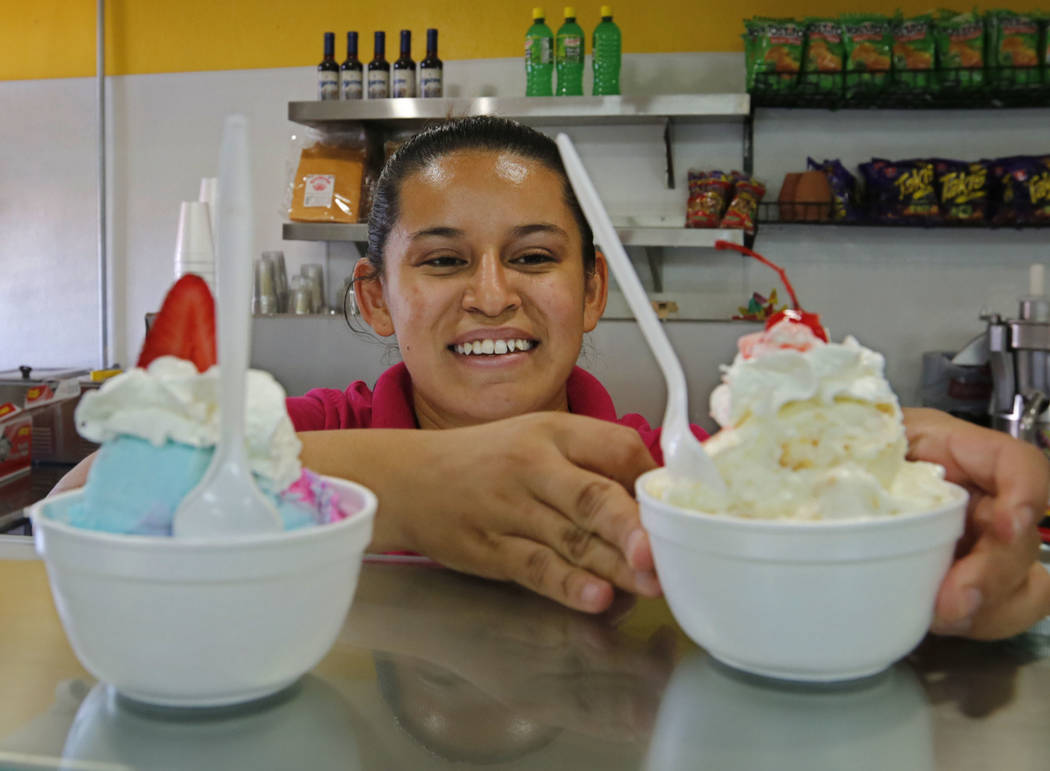 Staff member Nayeli Gonzalez shows cups of ice cream at La Flor de Michoacan in Las Vegas, Saturday, Aug. 26, 2017.  Chitose Suzuki Las Vegas Review-Journal @chitosephoto