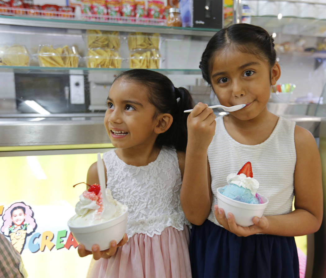 Angelina Gonzalez, 6, left, and her sister Vianna, 7, eat ice cream at their grandmother's shop, La Flor de Michoacan,  in Las Vegas, Saturday, Aug. 26, 2017.  Chitose Suzuki Las Vegas Review-Jour ...