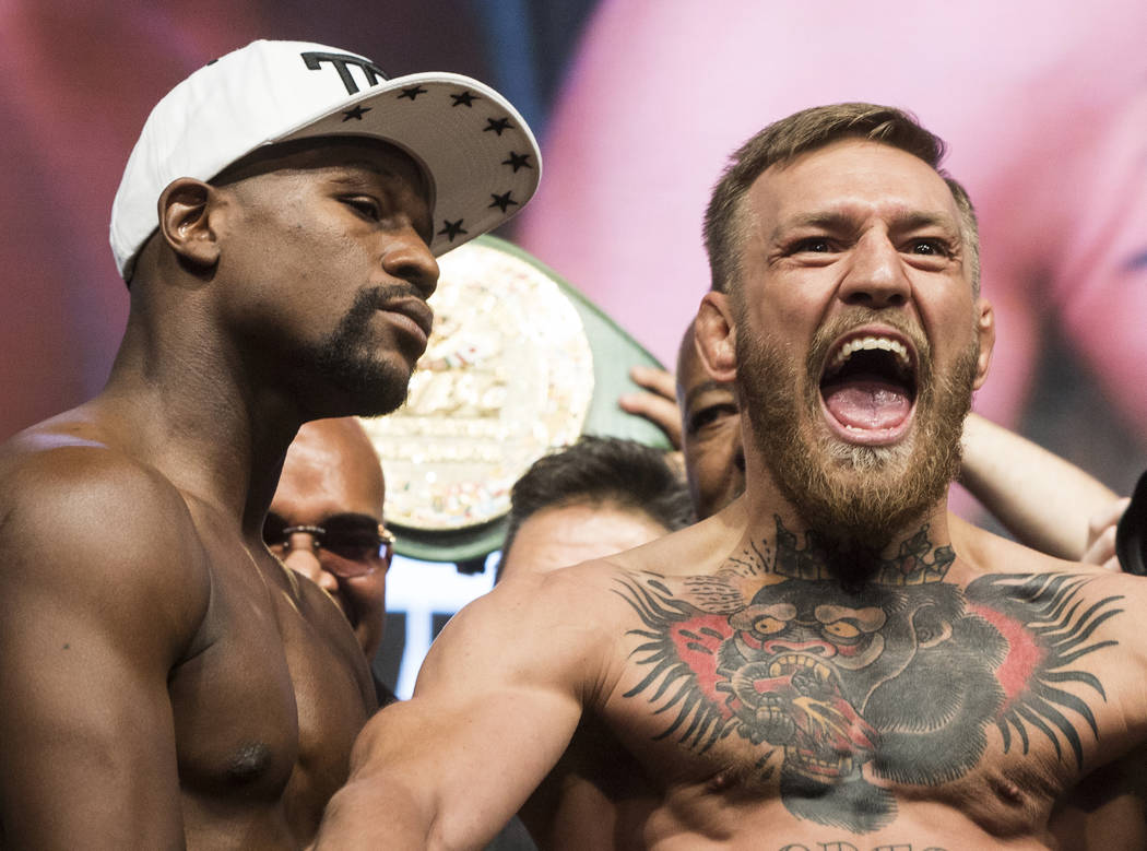 Conor McGregor, right, and Floyd Mayweather Jr. pump up the crowd during weigh-ins on Friday, Aug 25, 2017, at T-Mobile Arena, in Las Vegas. Benjamin Hager Las Vegas Review-Journal @benjaminhphoto