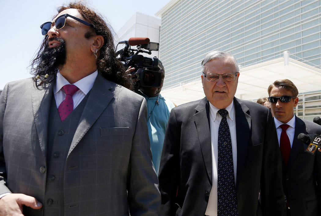 Former Maricopa County Sheriff Joe Arpaio, second from right, leaves U.S. District Court on the first day of his contempt-of-court trial with attorney Mark Goldman, left, in Phoenix on June 26. (A ...