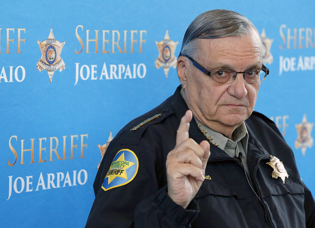 Maricopa County Sheriff Joe Arpaio pauses as he answers a question at a news conference at Maricopa County Sheriff's Office Headquarters in Phoenix Fin this Dec. 18, 2013 photo. (AP Photo/Ross D.  ...