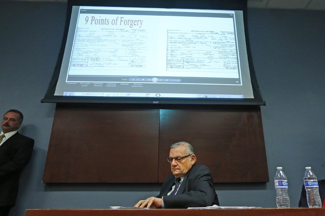 Maricopa County Sheriff Joe Arpaio listens to a video presentation of the findings from a five-year investigation into the authenticity of President Barack Obama's birth certificate during a press ...