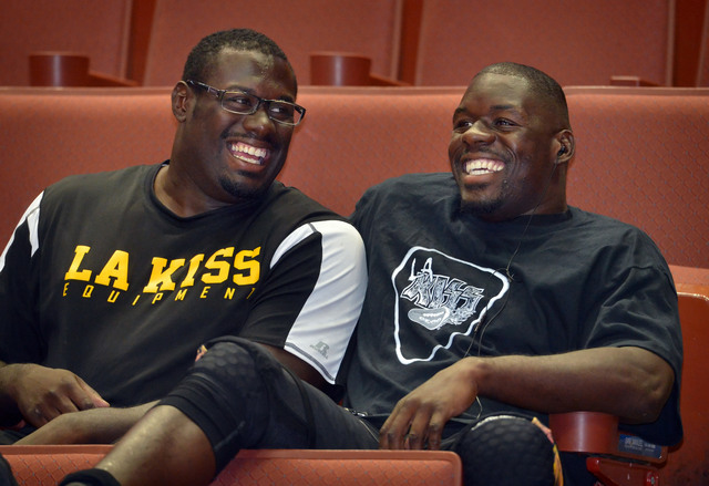 LA KISS arena football players B.J. Bell, left, and his older brother Beau Bell, relax in the stands less than 2 hours before game time as they get ready to host Portland Thunder at the Honda Cent ...