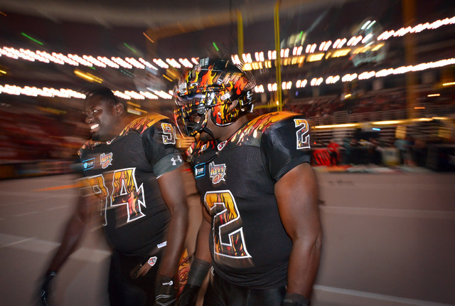 LA KISS and former UNLV football players B.J. Bell, left, and his brother Beau Bell gather on the field at the start of the LA KISS arena football game against Portland Thunder at the Honda Center ...