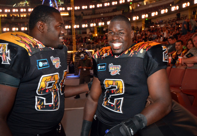 LA KISS and former UNLV football players B.J. Bell, left, and his brother Beau Bell gather on the field at the start of a LA KISS arena football game against Portland Thunder at the Honda Center i ...