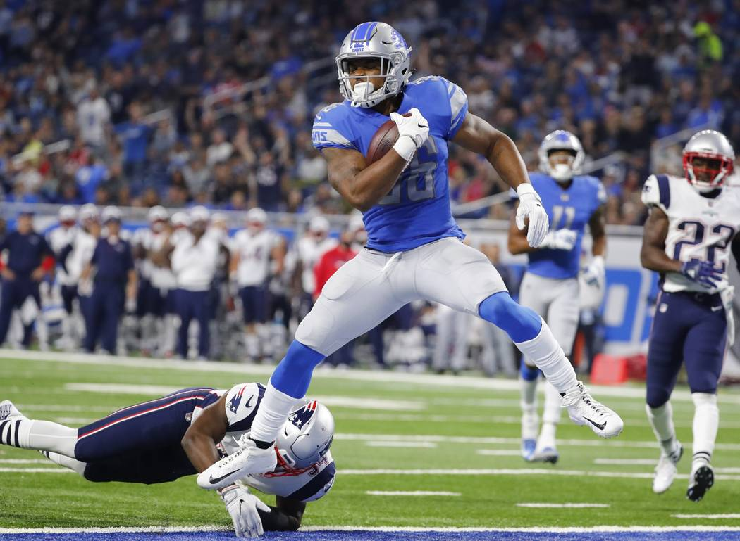 Detroit Lions running back Dwayne Washington (36) leaps into the end zone for an 18-yard rushing touchdown during the second half of an NFL preseason football game against the New England Patriots ...