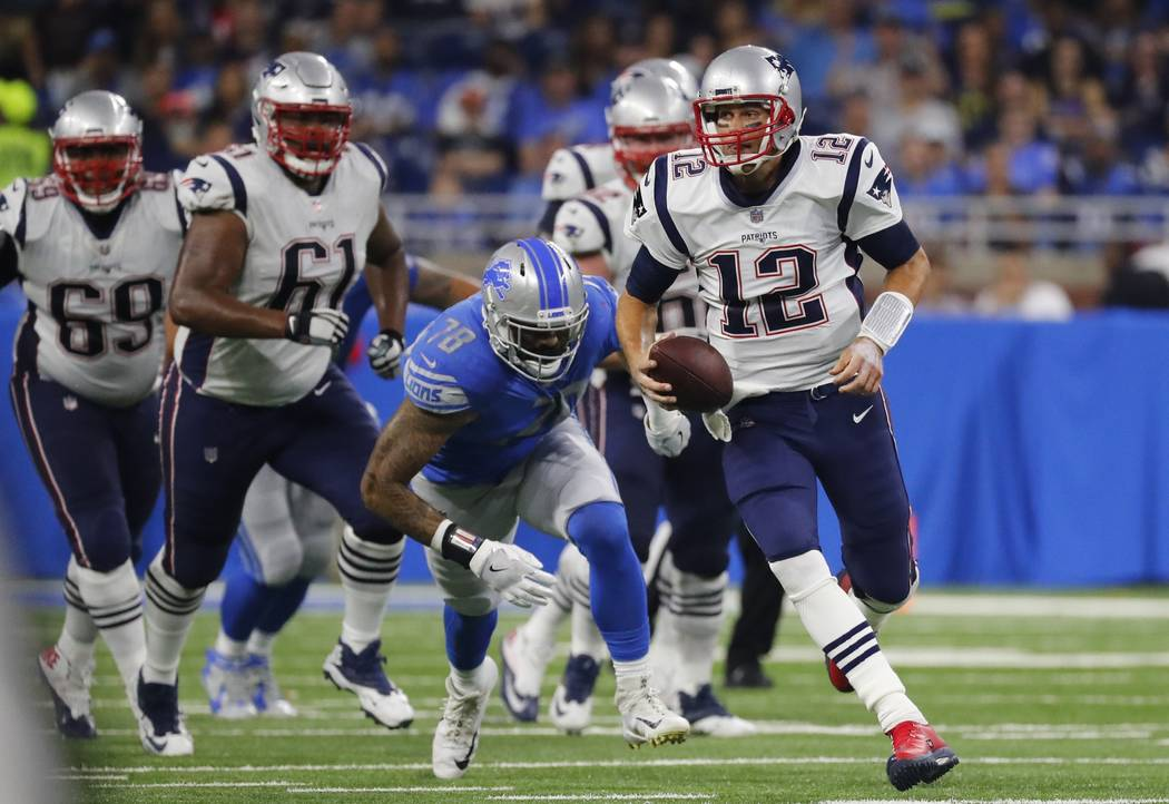 New England Patriots quarterback Tom Brady (12) scrambles during the first half of the team's NFL preseason football game against the Detroit Lions, Friday, Aug. 25, 2017, in Detroit. (AP Photo/Ri ...