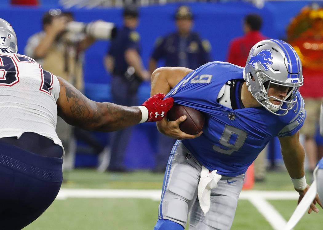 Detroit Lions quarterback Matthew Stafford (9) is sacked by New England Patriots defensive end Alan Branch (97) during the second half of an NFL preseason football game, Friday, Aug. 25, 2017, in  ...