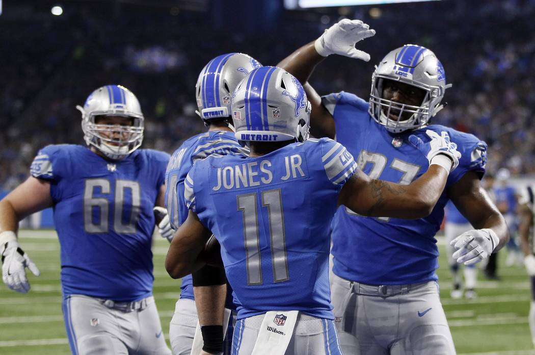 Detroit Lions wide receiver Marvin Jones (11) is congratulated after his 23-yard touchdown reception during the first half of an NFL preseason football game against the New England Patriots, Frida ...
