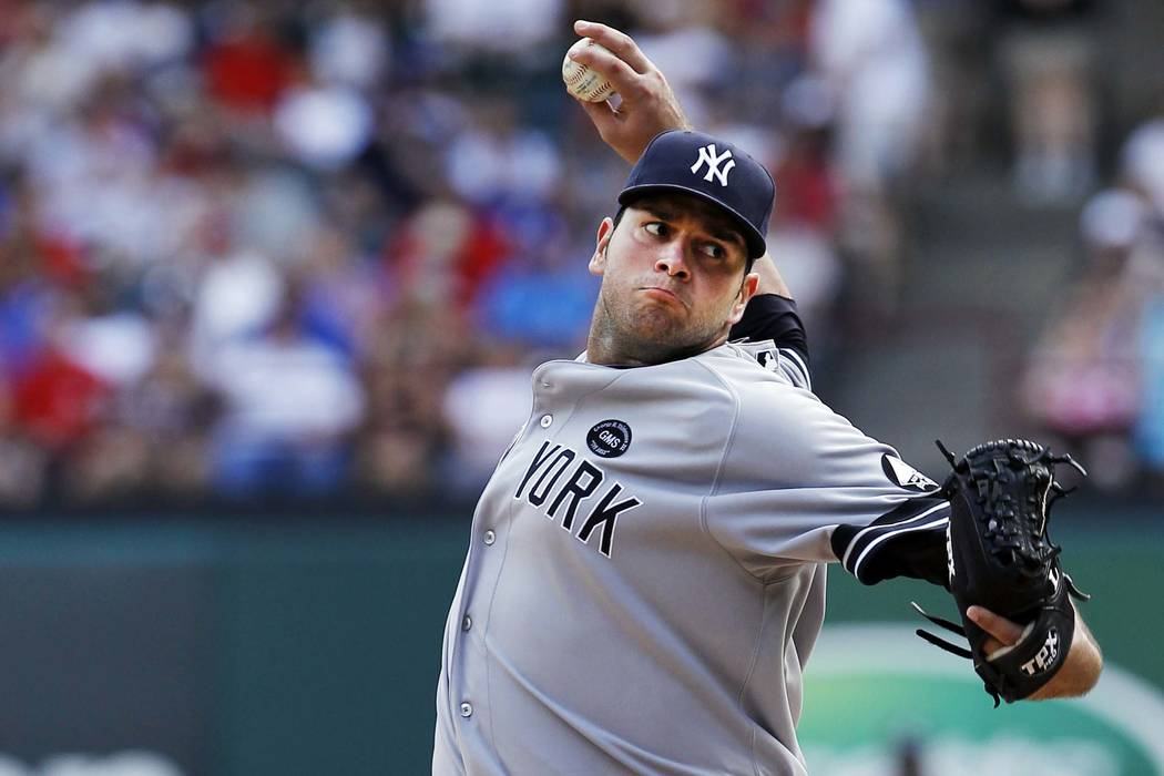 New York Yankees relief pitcher Jonathan Albaladejo throws a pitch in the seventh inning during a baseball game against the Texas Rangers on Sunday, Sept. 12, 2010, in Arlington, Texas. Texas won  ...
