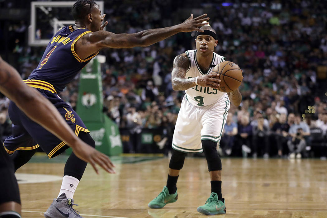 Boston Celtics guard Isaiah Thomas looks to pass the ball as Cleveland Cavaliers guard Iman Shumpert, left, defends during the first half of Game 2 of the NBA basketball Eastern Conference finals, ...