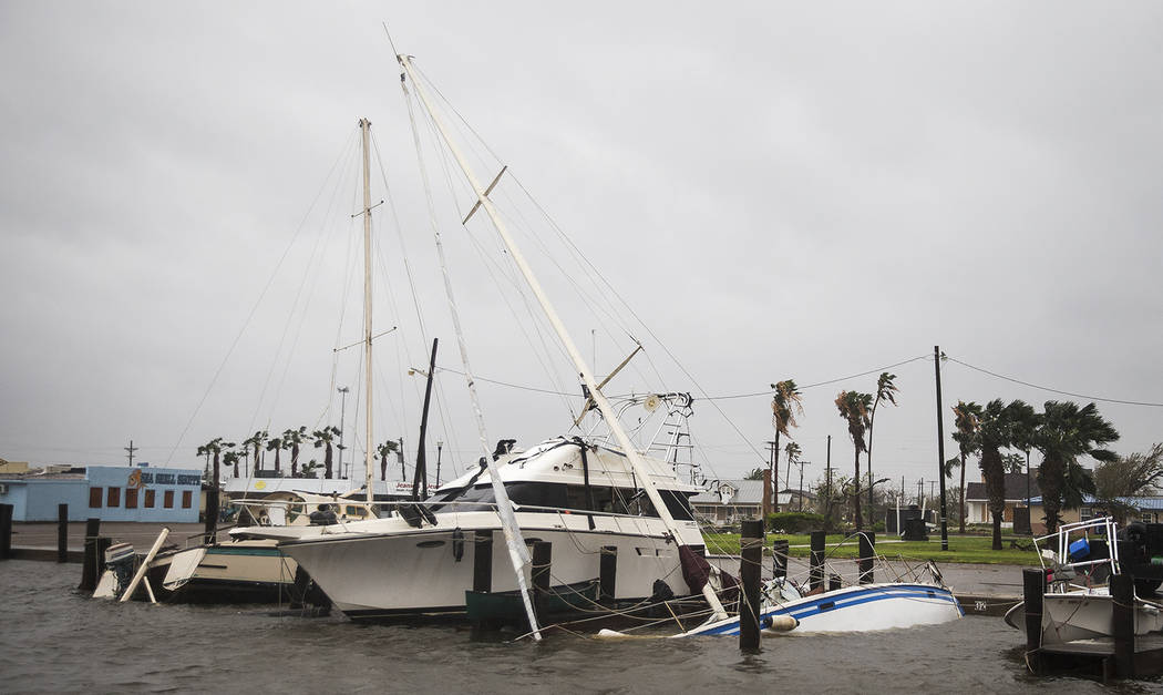 A boat sits capsized in the Rockport marina after Hurricane Harvey ripped through Rockport, Texas, on Saturday, Aug. 26, 2017.  The fiercest hurricane to hit the U.S. in more than a decade spun ac ...