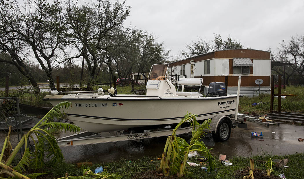 A boat sits in a driveway with debris strewn around it after Hurricane Harvey ripped through Rockport, Texas, on Saturday, Aug. 26, 2017.  The fiercest hurricane to hit the U.S. in more than a dec ...