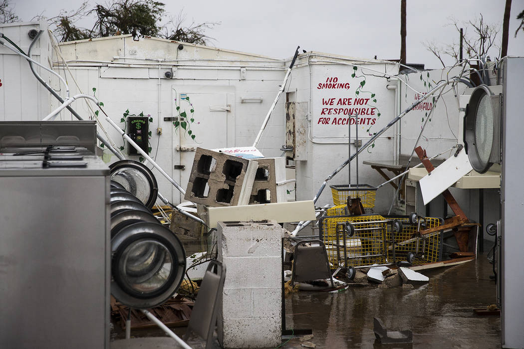A laundromat's machines sit exposed in the elements after Hurricane Harvey ripped through Rockport, Texas, on Saturday, Aug. 26, 2017.  The fiercest hurricane to hit the U.S. in more than a decade ...
