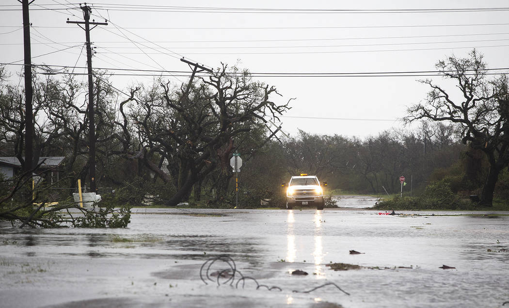 A vehicle drives through flooded roads after Hurricane Harvey ripped through Rockport, Texas, on Saturday, Aug. 26, 2017.  The fiercest hurricane to hit the U.S. in more than a decade spun across  ...