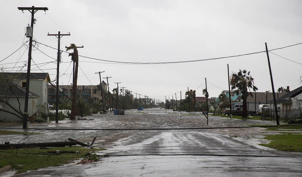 A road remains flooded after Hurricane Harvey ripped through Rockport, Texas, onSaturday, Aug. 26, 2017.  The fiercest hurricane to hit the U.S. in more than a decade spun across hundreds of miles ...