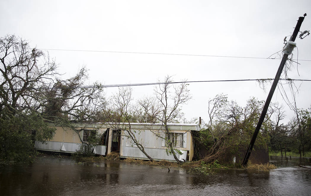 A trailer home sits lodged in trees after Hurricane Harvey ripped through Rockport, Texas, on Saturday, Aug. 26, 2017.  The fiercest hurricane to hit the U.S. in more than a decade spun across hun ...