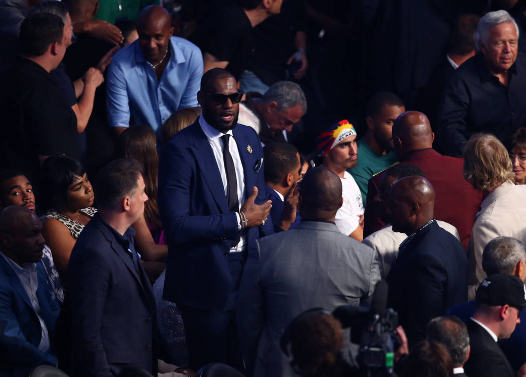 Lebron James takes his seat before the Floyd Mayweather Jr. and Conor McGregor fight at T-Mobile Arena, Saturday, Aug. 26, 2017, in Las Vegas. Chase Stevens Las Vegas Review-Journal