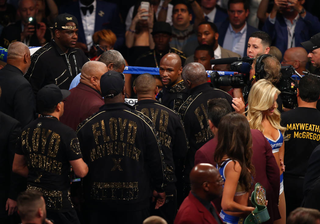 Floyd Mayweather Jr., center, enters the ring before his fight against Conor McGregor at T-Mobile Arena, Saturday, Aug. 26, 2017, in Las Vegas. Chase Stevens Las Vegas Review-Journal
