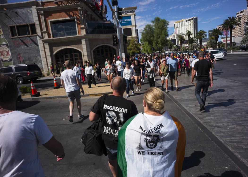 Fight fans walk along the Strip before Floyd Mayweather Jr. takes on Conor McGregor at T-Mobile Arena, Saturday, Aug. 26, 2017, in Las Vegas. Chase Stevens Las Vegas Review-Journal