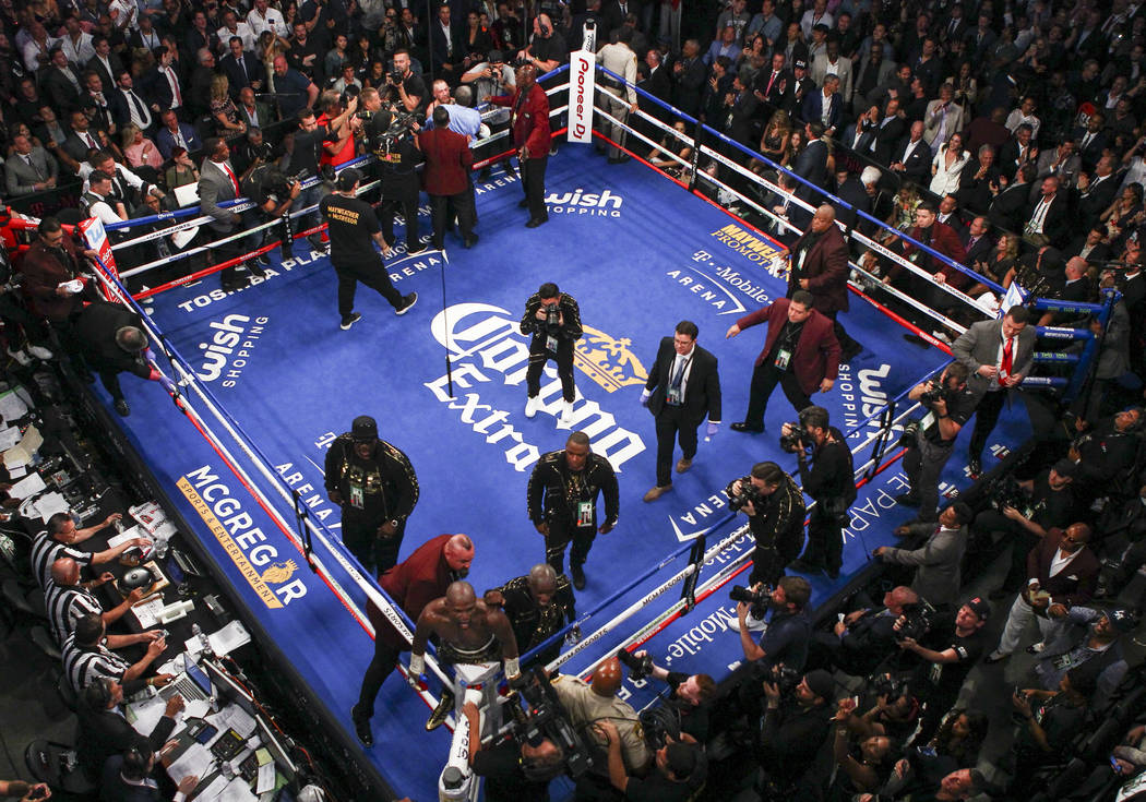 Floyd Mayweather Jr. reacts defeating Conor McGregor in their super welterweight fight at T-Mobile Arena, Saturday, Aug. 26, 2017, in Las Vegas. Mayweather won via 10th round technical knockout. C ...
