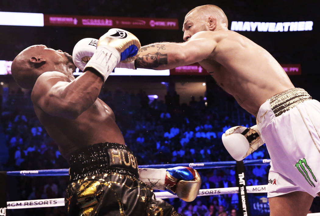 Conor McGregor, right, lands a punch against Floyd Mayweather Jr. in the 3rd round on Saturday, Aug 26, 2017, at T-Mobile Arena, in Las Vegas. Benjamin Hager Las Vegas Review-Journal @benjaminhphoto
