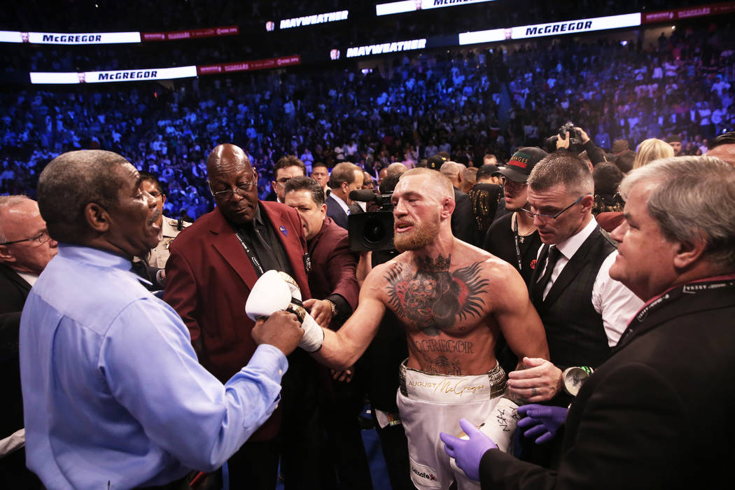 Conor McGregor, right, shakes referee Robert Byrd's hand after his TKO loss to Floyd Mayweather on Saturday, Aug 26, 2017, at T-Mobile Arena, in Las Vegas. Benjamin Hager Las Vegas Review-Journal  ...