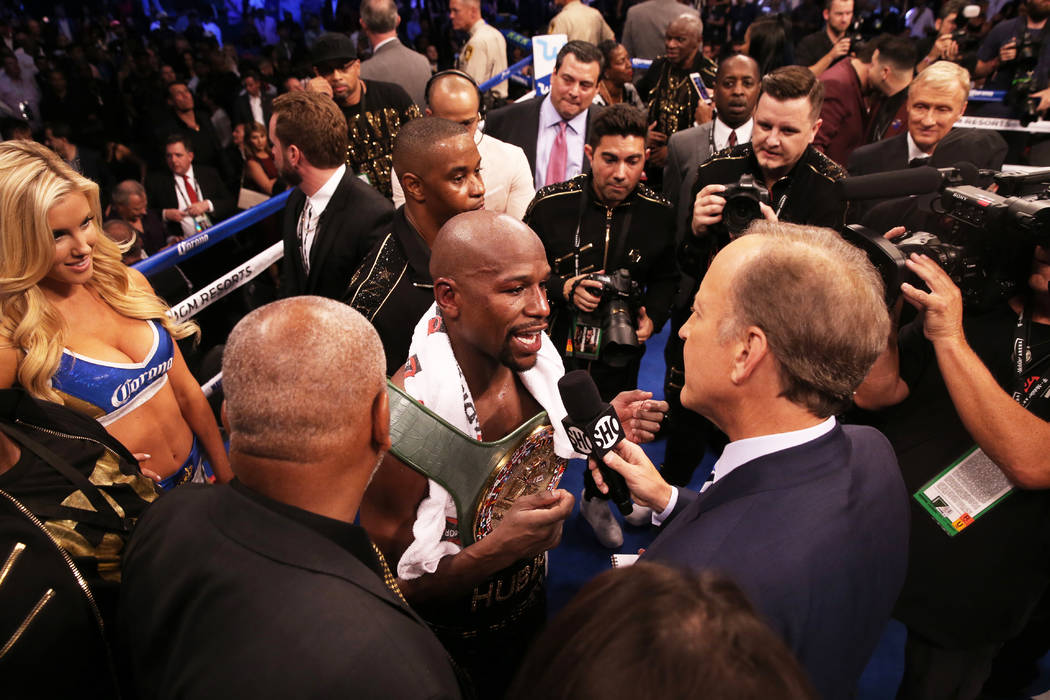 Floyd Mayweather, middle, answers questions from the media after his TKO victory over Conor McGregor in the blank round on Saturday, Aug 26, 2017, at T-Mobile Arena, in Las Vegas. Benjamin Hager L ...