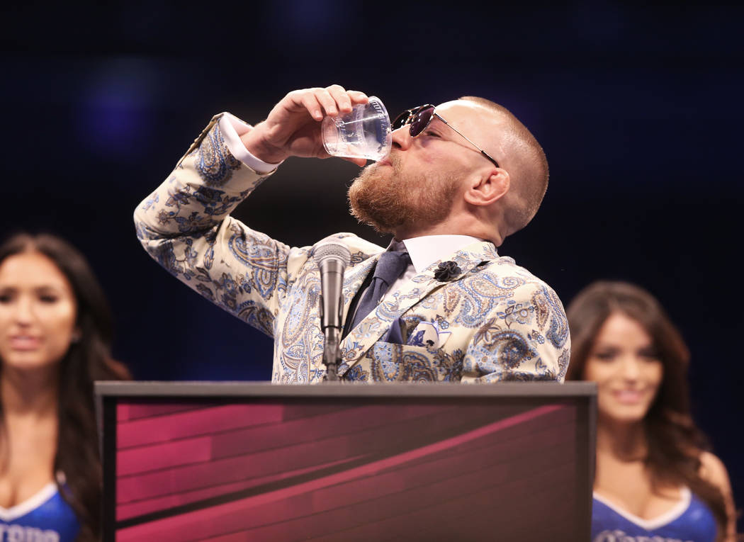 Conor McGregor drinks whiskey at the post fight press conference after his loss to Floyd Mayweather on Saturday, Aug 26, 2017, at T-Mobile Arena, in Las Vegas. Benjamin Hager Las Vegas Review-Jour ...