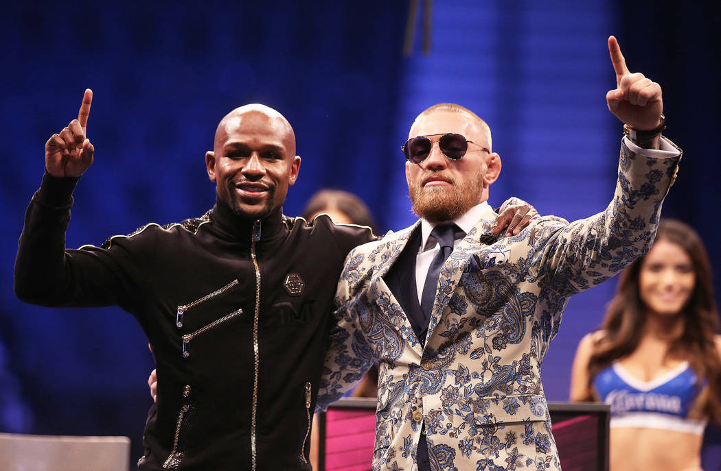 Floyd Mayweather, left, and Conor McGregor salute the crowd at the post fight press conference on Saturday, Aug 26, 2017, at T-Mobile Arena, in Las Vegas. Benjamin Hager Las Vegas Review-Journal @ ...