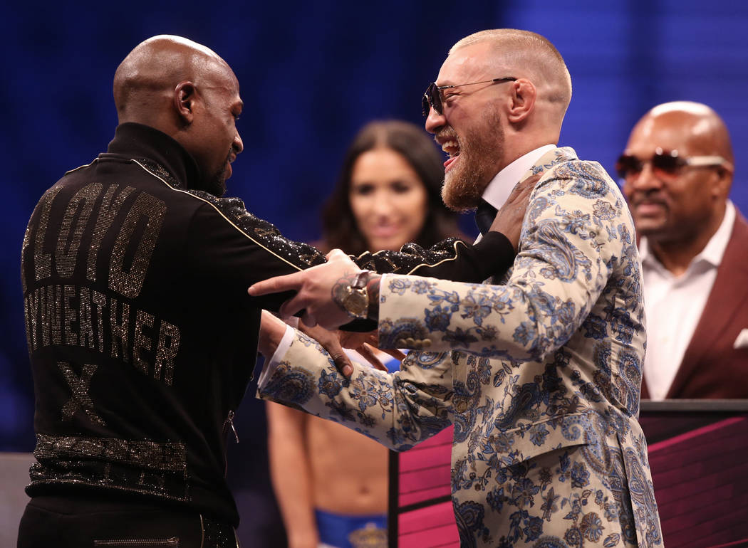 Floyd Mayweather, left, and Conor McGregor joke around at the post fight press conference on Saturday, Aug 26, 2017, at T-Mobile Arena, in Las Vegas. Benjamin Hager Las Vegas Review-Journal @benja ...