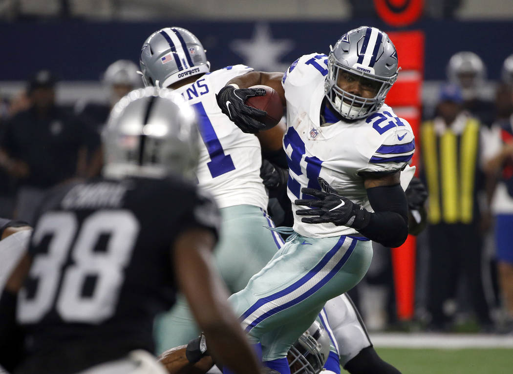 Oakland Raiders cornerback TJ Carrie (38) gives chase as Dallas Cowboys running back Ezekiel Elliott (21) runs the ball through the line of scrimmage in the first half of a preseason NFL football  ...