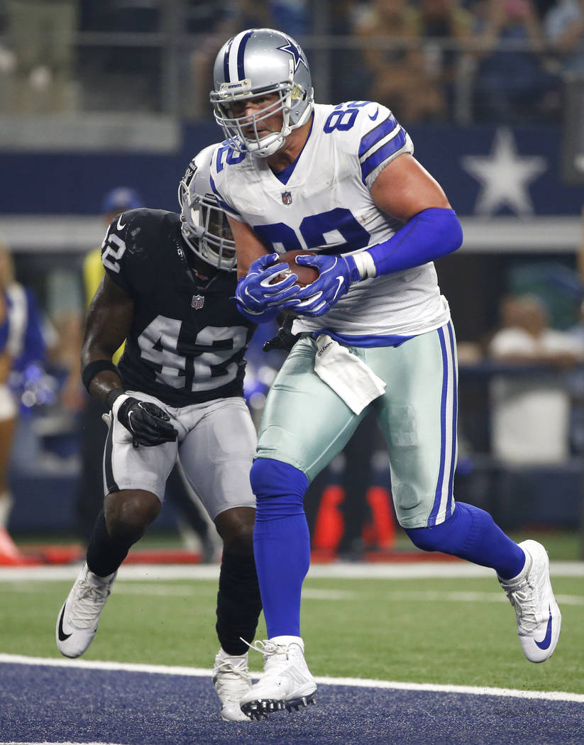 Dallas Cowboys tight end Jason Witten (82) catches a pass for a touchdown in front of Oakland Raiders safety Karl Joseph (42) in the first half of a preseason NFL football game, Saturday, Aug. 26, ...